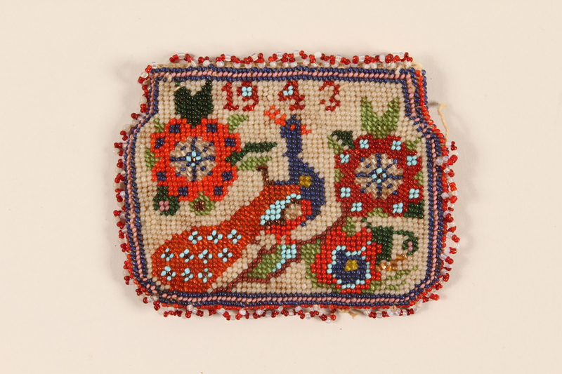 2002.515.1 front Coin purse with a beaded peacock design with the year 1943