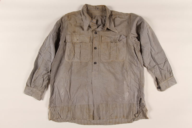 2002.175.1 front Shirt taken from an SS storeroom at a concentration camp by a Hungarian Jewish inmate and worn after liberation