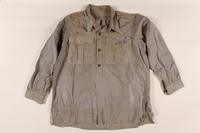2002.175.1 front Shirt taken from an SS storeroom at a concentration camp by a Hungarian Jewish inmate and worn after liberation  Click to enlarge