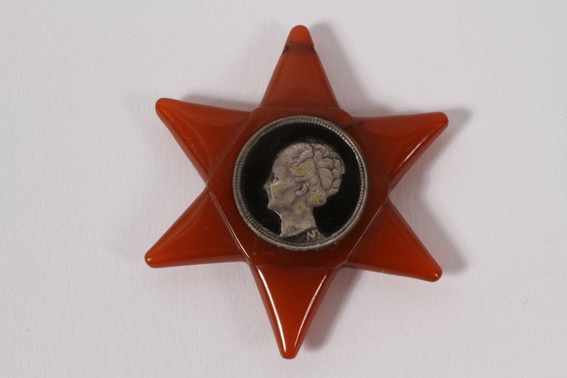 2005.360.1 front Star of David pin made from a Dutch coin worn to protest the German occupation and persecution of the Jews