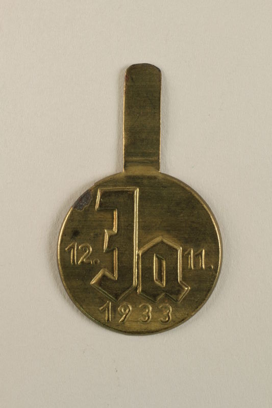 2002.178.2 front Nazi Party badge issued for the 1933 election