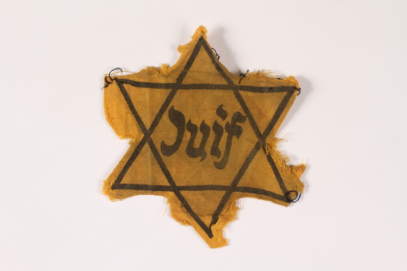 2002.189.2 front Yellow Star of David badge