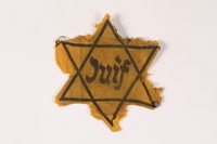2002.189.2 front Yellow Star of David badge  Click to enlarge