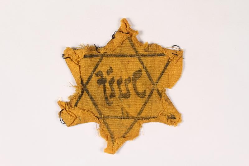 2002.189.2 back Yellow Star of David badge
