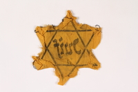2002.189.2 back Yellow Star of David badge  Click to enlarge
