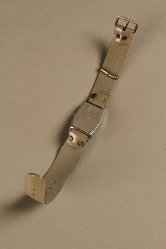 2002.270.2 bottom open Wrist watch with a gray plastic band