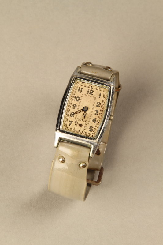 2002.270.2 front detail Wrist watch with a gray plastic band