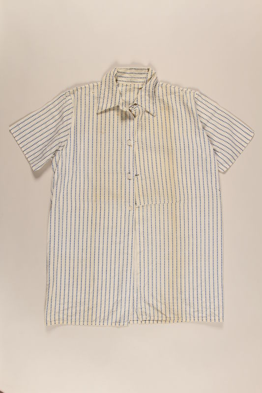 2000.490.1 front Blue and white vertical striped shirt worn in a displaced persons camp