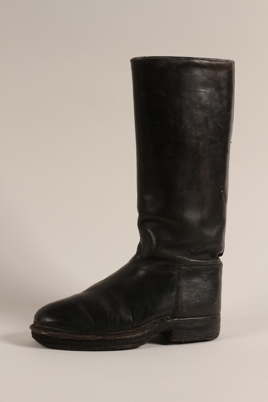 2002.366.1 a front Black leather mid-calf boots worn by a female Jewish concentration camp prisoner