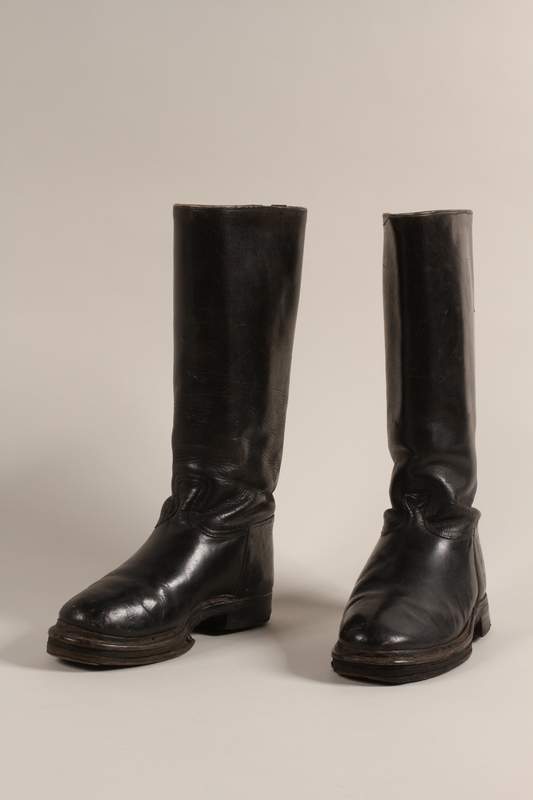 2002.366.1 a-b front Black leather mid-calf boots worn by a female Jewish concentration camp prisoner