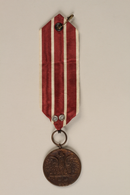2000.226.6 front Medal and maroon and white ribbon