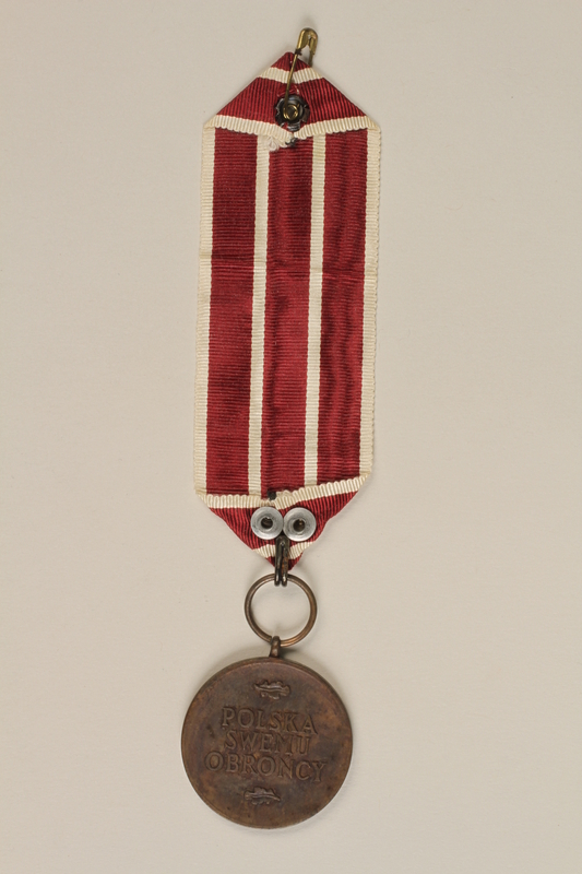 2000.226.6 back Medal and maroon and white ribbon