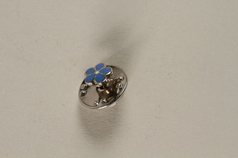 2001.329.1 front Forget--Me-Not pin issued postwar to honor German Freemasons