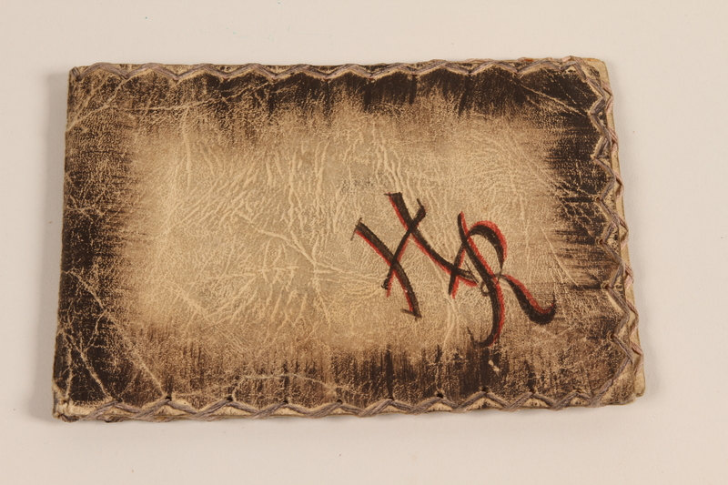 2002.436.4 front Monogrammed paper pouch with a painted floral design used in the Theresienstadt ghetto