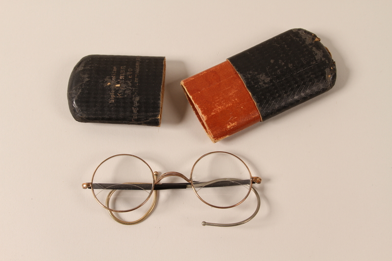 2002.438.5 a-b open Eyeglasses and case used by a Jewish man who fled Nazi occupied Belgrade with his family
