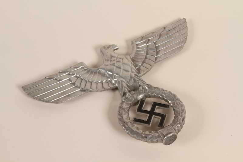 2000.510.2 front Silver Reichsadler flagpole ornament that was removed from a flagpole