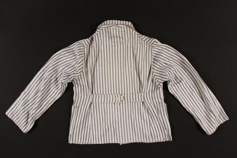 2002.467.1 back Concentration camp uniform jacket with post liberation Buchenwald patch worn by a Romanian Jewish inmate