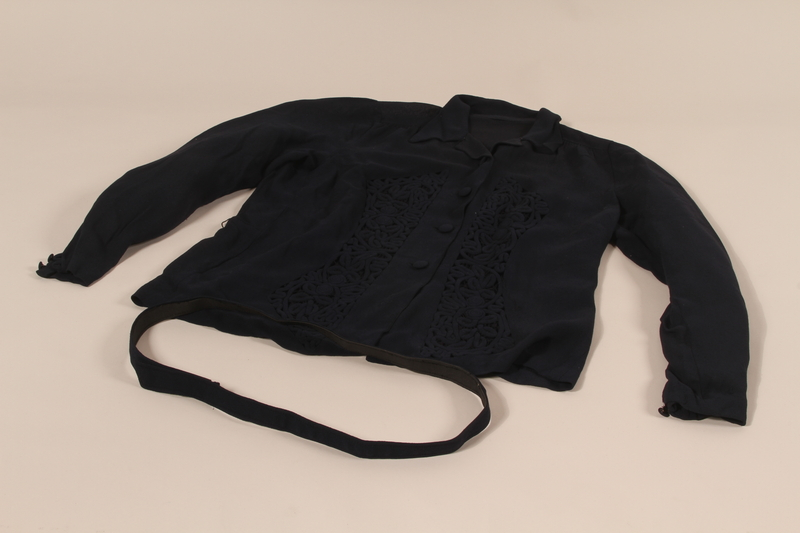 2002.474.2 a-b front Navy openwork jacket with belt made by a German Jewish woman