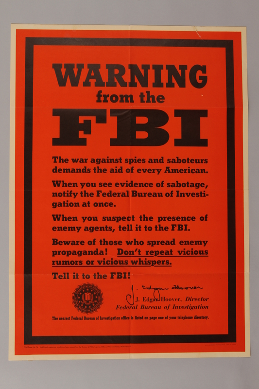 1988.42.51 front US careless talk text only orange poster warning about suspicious people