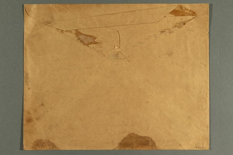 1988.42.60 b back Light brown paper envelope used for mailing war posters