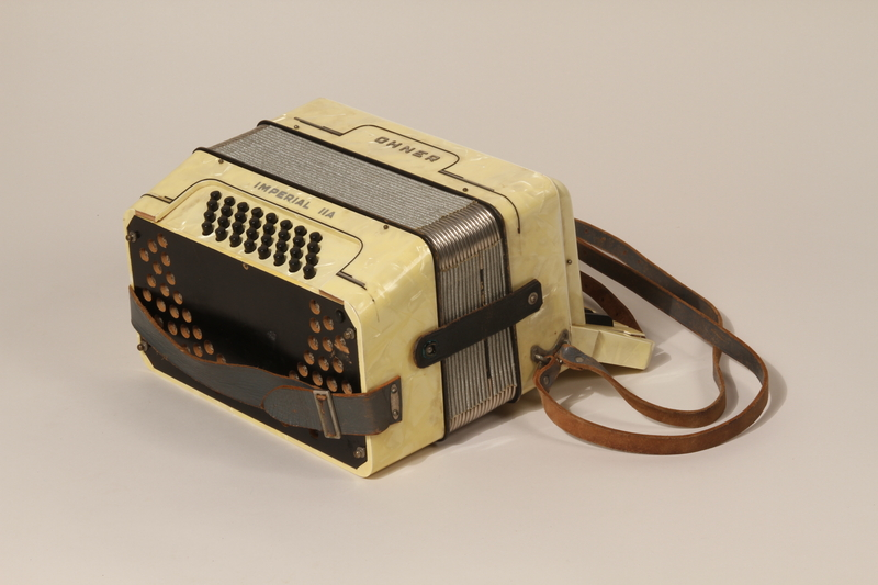 2003.352.1 a front Hohner Imperial IIA accordion and case carried by a young Jewish girl on a Kindertransport