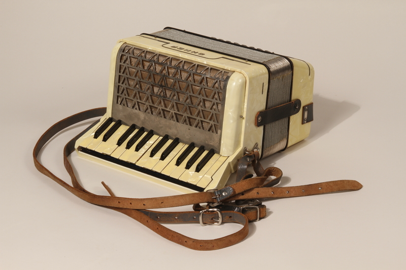 2003.352.1 a back Hohner Imperial IIA accordion and case carried by a young Jewish girl on a Kindertransport