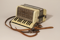 2003.352.1 a back Hohner Imperial IIA accordion and case carried by a young Jewish girl on a Kindertransport  Click to enlarge