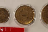 1988.106.1.4 front France currency, 1 franc coin  Click to enlarge
