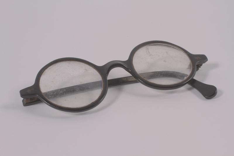 2003.198.8 front Black Bakelite circular eyeglasses worn by a Hungarian Jewish man on the Kasztner train