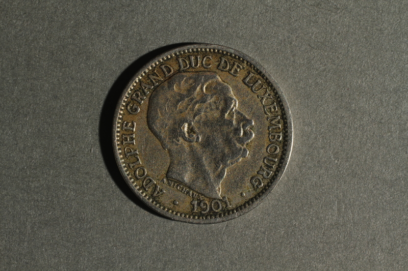1988.106.1.19 front Luxembourg currency, 10 centimes coin
