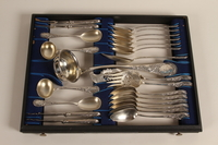 1992.45.5_a-d top shelf Baroque silverware service with case  Click to enlarge