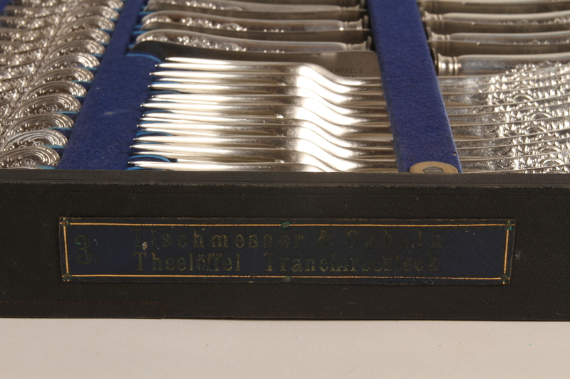 1992.45.5_a-d front Baroque silverware service with case