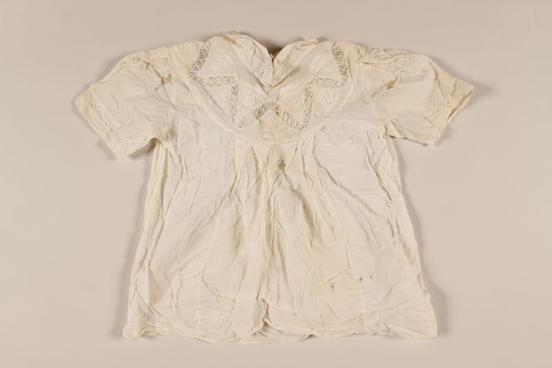 2002.57.13 front Child's white cotton dress with lace and embroidery