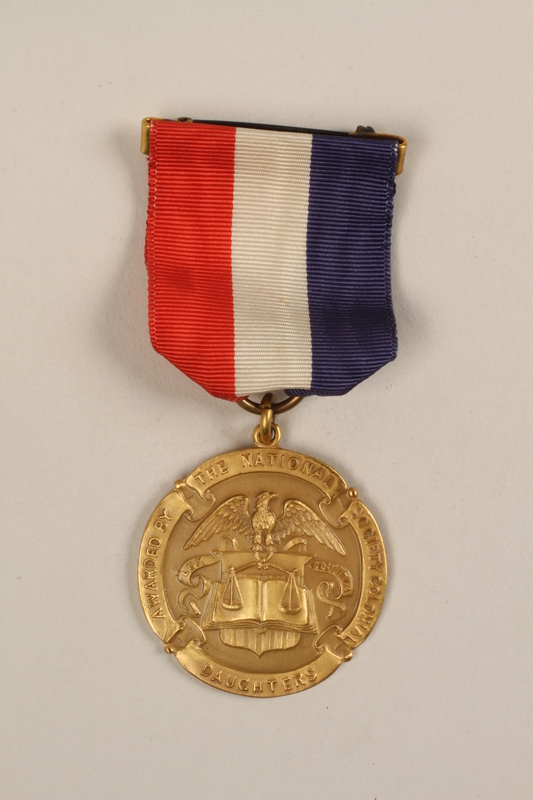 1989.277.18_a front National Society of Colonial Daughters essay award with case won by a Polish Jewish refugee