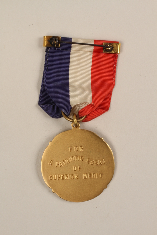 1989.277.18_a back National Society of Colonial Daughters essay award with case won by a Polish Jewish refugee