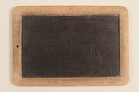 1990.45.2 front Small slate and wood blackboard used by schoolchildren in Nazi Germany  Click to enlarge