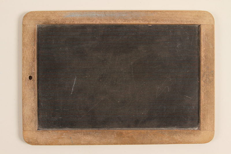 1990.45.2 back Small slate and wood blackboard used by schoolchildren in Nazi Germany