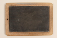 1990.45.2 back Small slate and wood blackboard used by schoolchildren in Nazi Germany  Click to enlarge