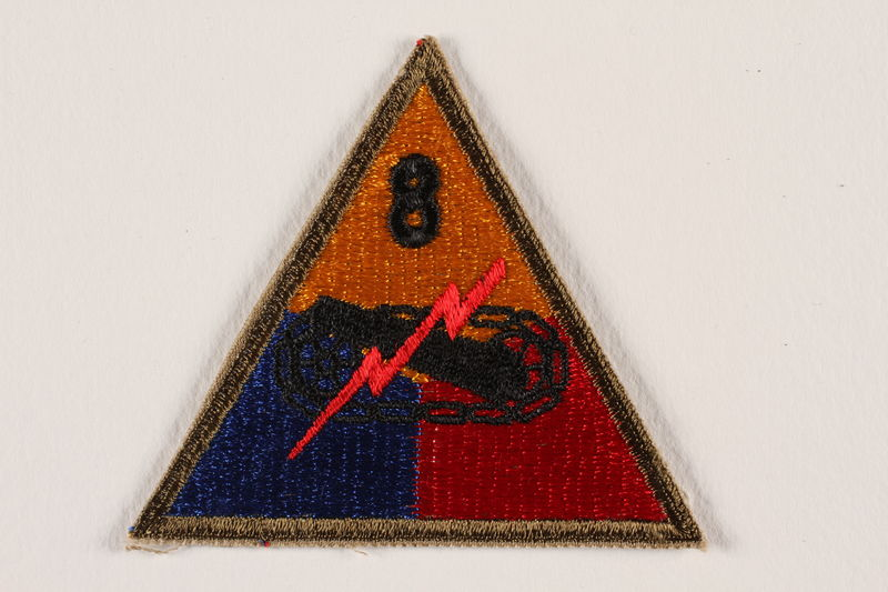 2000.561.5 front US Army 8th Armored Division shoulder sleeve patch with tank, gun, and red lightning bolt