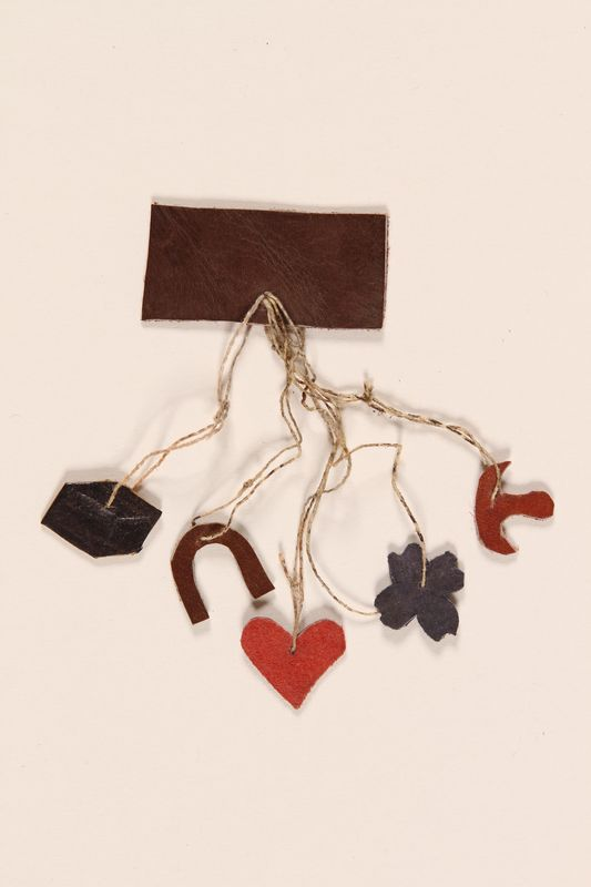 1988.126.30 front Leather charm pin made from scraps by an inmate in Bergen-Belsen