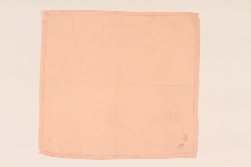 2003.454.3 front Peach handkerchief with a pink monogram carried by a Kindertransport refugee