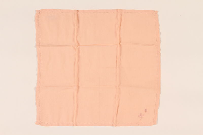 2003.454.4 front Pale orange handkerchief with a pink monogram carried by a Kindertransport refugee