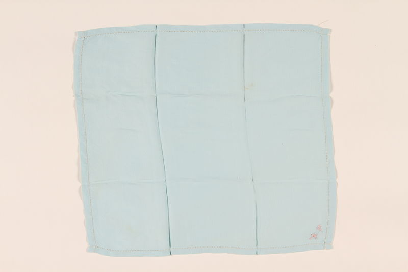 2003.454.5 front Light blue handkerchief with a pink monogram carried by a Kindertransport refugee