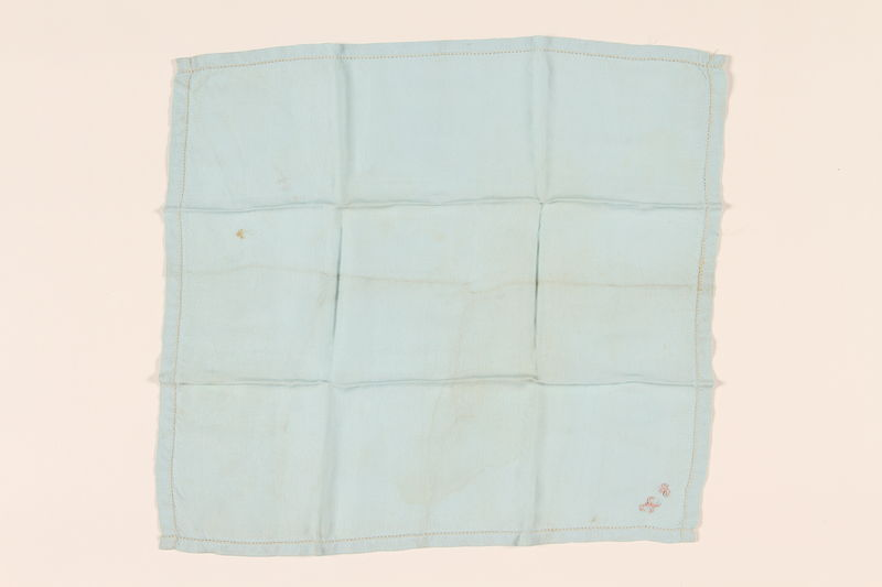 2003.454.6 front Light blue handkerchief with a pink monogram carried by a Kindertransport refugee