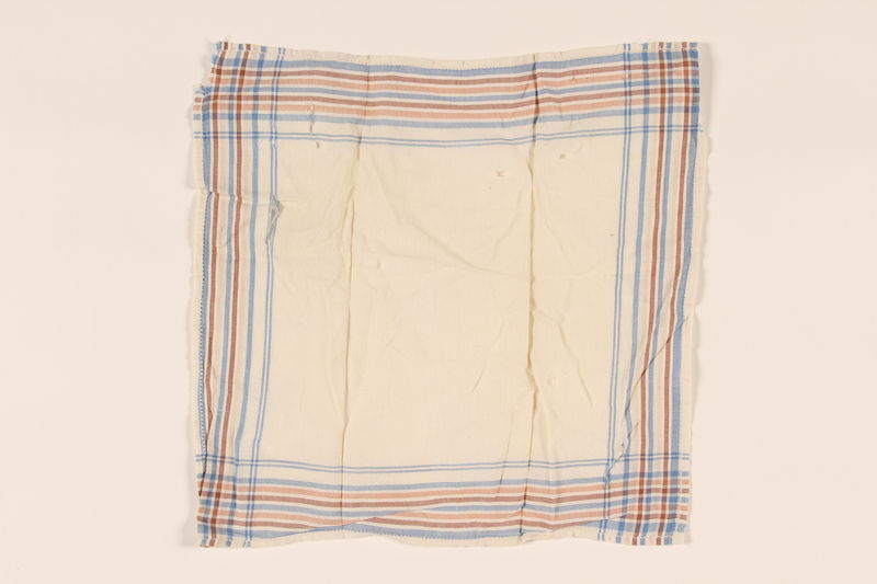 2003.454.11 front White handkerchief with blue, brown, and white stripes carried by a Kindertransport refugee