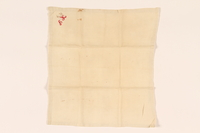 2003.454.12 front Offwhite handkerchief with a red monogram carried by a Kindertransport refugee  Click to enlarge