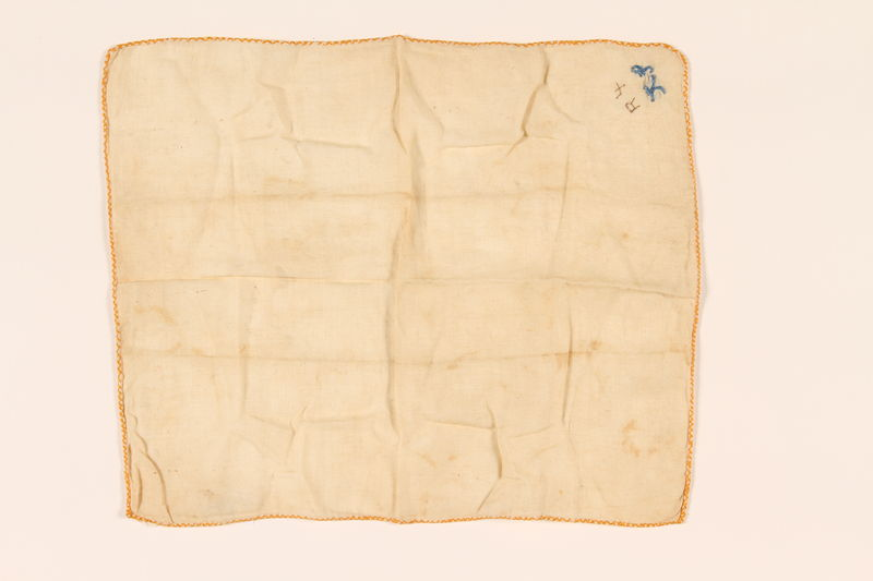2003.454.13 front Offwhite handkerchief with a blue embroidered monogram carried by a Kindertransport refugee