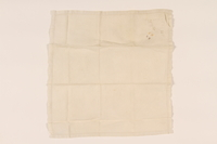 2003.454.14 front Offwhite handkerchief with floral whitework and a yellow monogram carried by a Kindertransport refugee  Click to enlarge