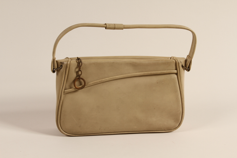 2003.454.18 front Beige leather purse with decorative piping used by a Kindertransport refugee