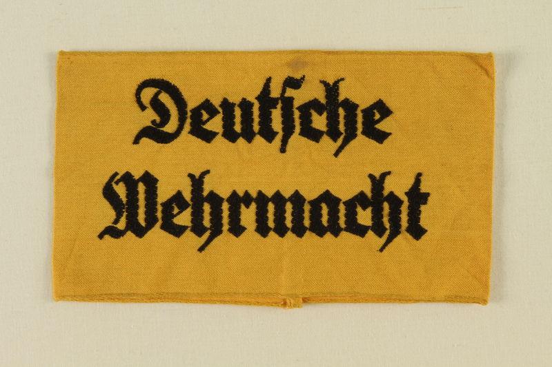 1989.113.2 front Deutsche Wehrmacht yellow cloth armband